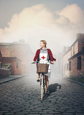 Mark Owen NURSE RIDING BIKE ON COBBLED STREET Women