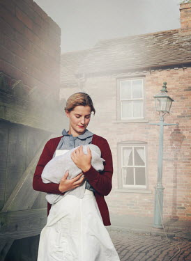 Mark Owen BLONDE WOMAN HOLDING BABY BY HOUSE IN STREET Women