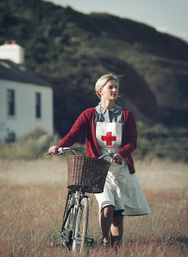 Mark Owen BLONDE NURSE WITH BICYCLE BY HOUSE IN COUNTRYSIDE Women