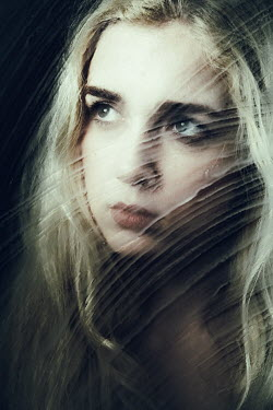 Magdalena Russocka close up of blonde woman behind wet glass