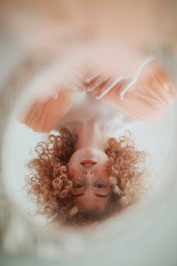Jovana Rikalo WOMAN WITH RED CURLY HAIR REFLECTED IN MIRROR Women
