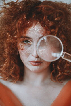 Jovana Rikalo WOMAN WITH RED CURLY HAIR AND MAGNIFYING GLASS Women