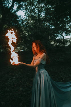Jovana Rikalo WOMAN IN SILK GOWN HOLDING FIRE IN COUNTRYSIDE Women