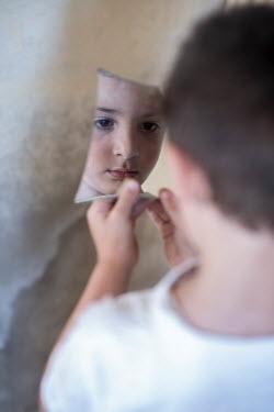 Mohamad Itani LITTLE BOY REFLECTED IN BROKEN PIECE OF MIRROR Children
