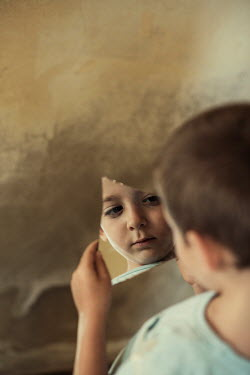 Mohamad Itani LITTLE BOY REFLECTED IN BROKEN PIECE OF MIRROR Children