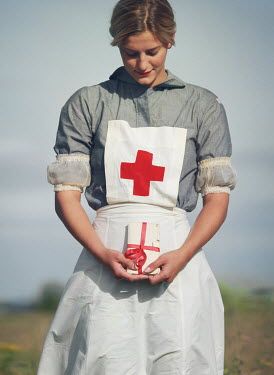 Mark Owen BLONDE NURSE HOLDING BUNDLE OF LETTERS OUTDOORS Women