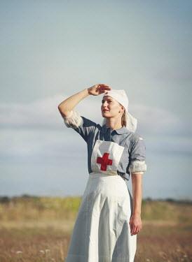Mark Owen NURSE IN SUNLIT FIELD WATCHING SKY Women