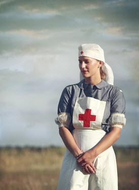 Mark Owen NURSE STANDING IN SUMMERY COUNTRYSIDE Women
