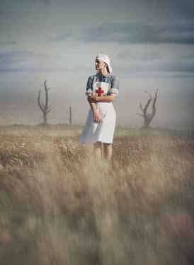 Mark Owen NURSE STANDING IN COUNTRYSIDE WITH DEAD TREES Women