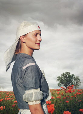 Mark Owen BLONDE NURSE STANDING IN POPPY FIELD Women