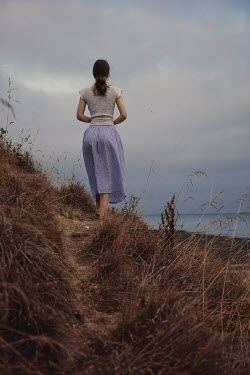 Shelley Richmond GIRL WALKING ON PATH IN DUNES BY SEA Women