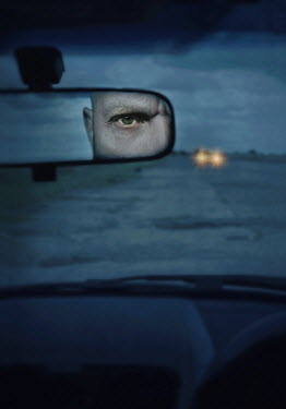 Lyn Randle MAN REFLECTED IN CAR MIRROR AT DUSK Men