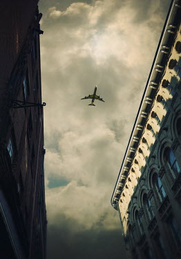 Lyn Randle AEROPLANE IN SKY WITH URBAN BUILDINGS Miscellaneous Transport