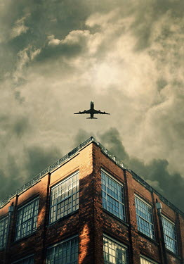 Lyn Randle AEROPLANE IN SKY WITH URBAN BUILDING Miscellaneous Transport