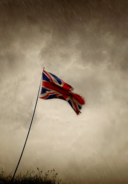 Lyn Randle FRAYED UNION JACK FLAG IN RAIN Miscellaneous Objects