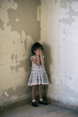 Mohamad Itani LITTLE GIRL IN PATTERNED DRESS CRYING INDOORS Children