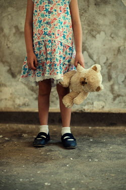 Mohamad Itani LITTLE GIRL CARRYING TEDDY IN SHABBY BUILDING Children