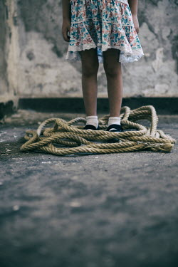Mohamad Itani LITTLE GIRL STANDING WITH ROPE IN DERELICT BUILDING Children