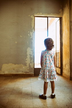 Mohamad Itani LITTLE GIRL STANDING IN DERELICT BUILDING Children