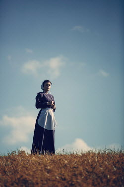 Magdalena Russocka amish woman standing in field