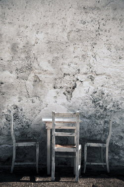 Paolo Martinez WHITE WOODEN TABLE AND CHAIRS BY CRUMBING WALL Miscellaneous Objects