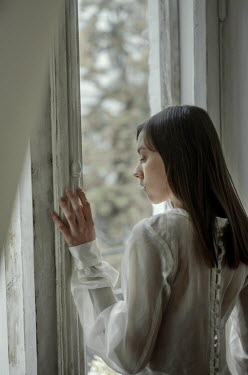 Svitozar Bilorusov BRUNETTE GIRL IN WHITE WATCHING AT WINDOW Women