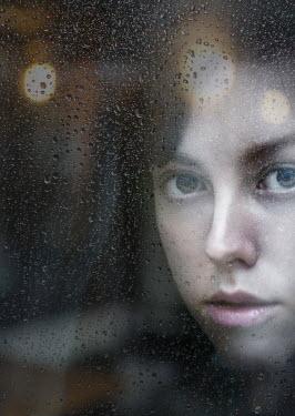Svitozar Bilorusov WOMAN STARING FROM BEHIND WET WINDOW Women