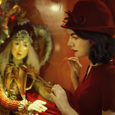 Svitozar Bilorusov WOMAN IN HAT WATCHING PUPPET IN WINDOW Women