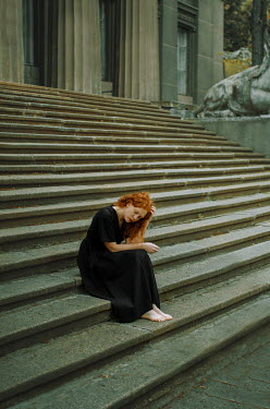 Svitozar Bilorusov WOMAN WITH RED HAIR SITTING ON STEPS BY GRAND BUILDING Women