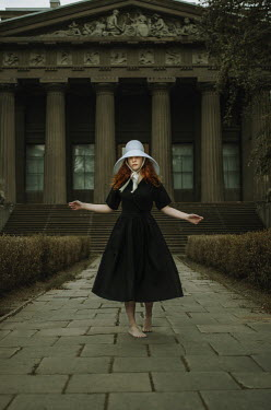 Svitozar Bilorusov BAREFOOT WOMAN IN HAT OUTSIDE GRAND BUILDING Women