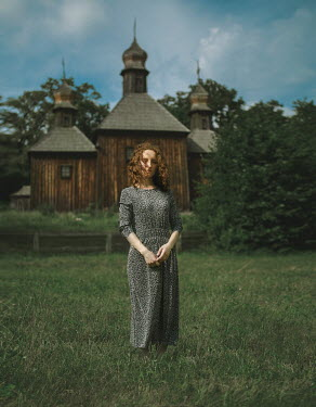 Svitozar Bilorusov WOMAN STANDING BY BUILDING WITH DOMES Women