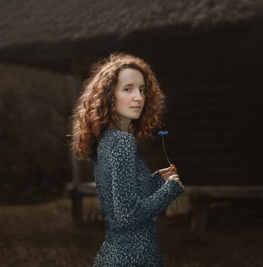 Svitozar Bilorusov WOMAN WITH RED HAIR STANDING BY BARN Women
