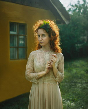 Svitozar Bilorusov WOMAN IN LACY DRESS BY COTTAGE WITH LEAF IN HAIR Women