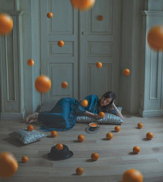 Svitozar Bilorusov WOMAN LYING INDOORS WITH FALLING ORANGES Women