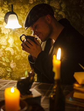 Svitozar Bilorusov MAN SMELLING COFFEE INDOORS WITH CANDLES Men