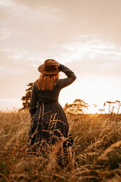 Shelley Richmond GIRL WITH HAT IN GOLDEN FIELD AT SUNSET Women