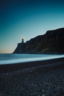Evelina Kremsdorf LIGHTHOUSE ON CLIFF BY SEA AT DUSK Miscellaneous Buildings