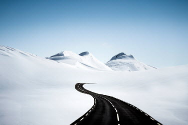 Evelina Kremsdorf EMPTY ROAD IN SNOWY LANDSCAPE WITH MOUNTAINS Snow/ Ice