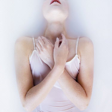 Meg Cowell GIRL LYING IN MILKY WATER Women
