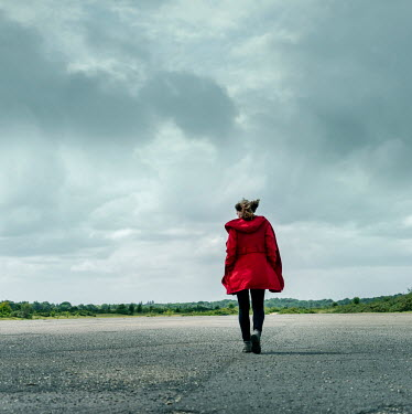 CollaborationJS WOMAN IN RED COAT WALKING IN WINDY COUNTRYSIDE Women