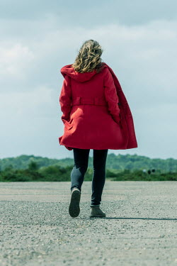 CollaborationJS WOMAN IN RED COAT WALKING IN COUNTRYSIDE Women