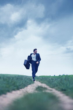 CollaborationJS MAN RUNNING IN COUNTRYSIDE CARRYING SUITCASE Men