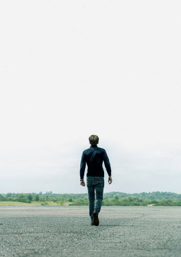 CollaborationJS MAN IN JEANS WALKING IN COUNTRYSIDE Men