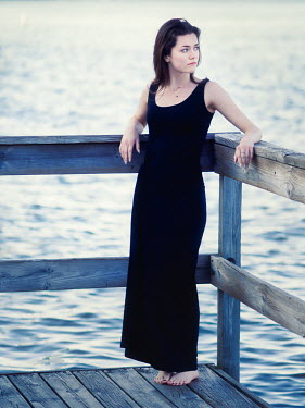 Elisabeth Ansley BAREFOOT BRUNETTE GIRL ON JETTY BY WATER Women