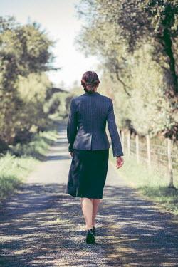 Marie Carr BRUNETTE WOMAN WALKING IN SUMMERY COUNTRY LANE Women