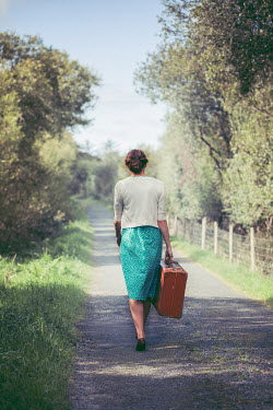 Marie Carr GIRL CARRYING SUITCASE IN COUNTRY LANE Women