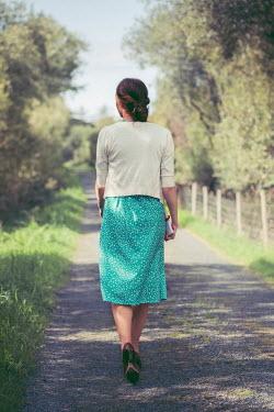 Marie Carr WOMAN IN DRESS WALKING IN COUNTRY LANE Women