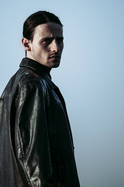 Magdalena Russocka MAN WITH DARK HAIR IN LEATHER JACKET OUTDOORS