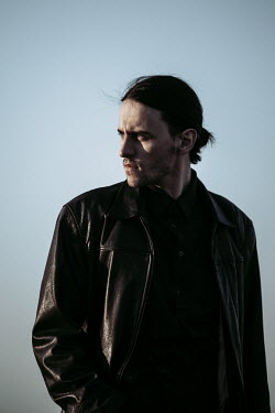Magdalena Russocka modern man in leather jacket outside