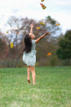 Susan Fox YOUNG GIRL THROWING LEAVES IN PARK Children